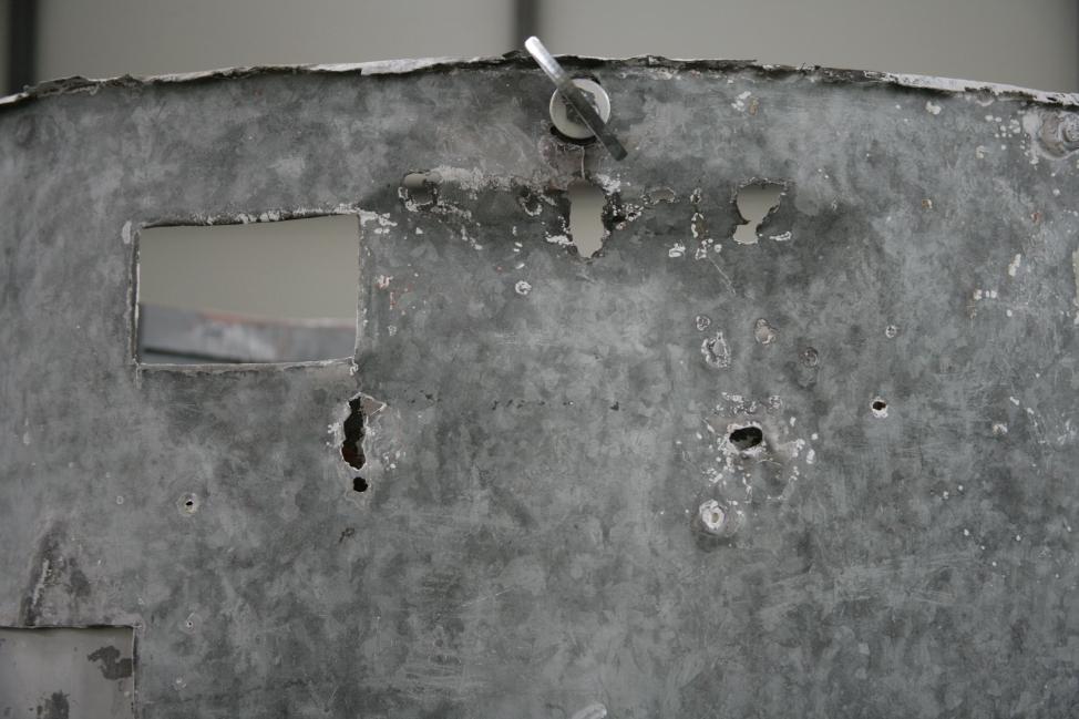 Poškodba zgornjega dela plašča, kjer so bile originalne pletenice za vpetje stolpa (ZVKDS RC – V. Benedik).
